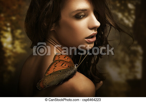 Portrait of a beauty brunette with butterfly - csp6464223