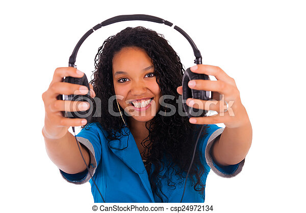 Portrait of a black woman with headphones listening to - csp24972134
