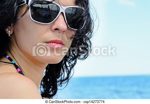 Portrait of a brunette on the beach - csp14273774