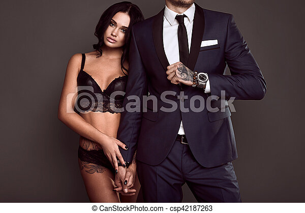 Sexy girl with a man
