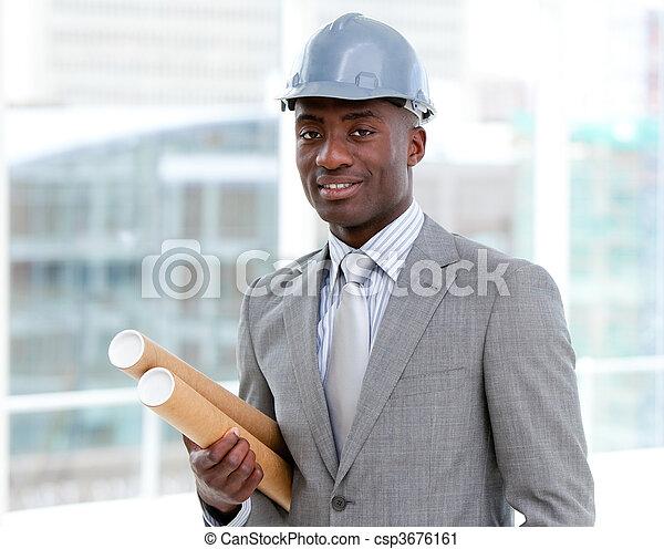 Portrait of a charismatic male architect holding blueprints - csp3676161
