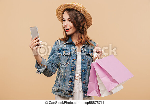 Portrait of a cheerful young girl in summer clothes - csp58875711