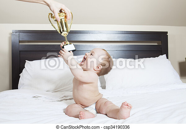 Portrait of a crawling baby on the bed in her room - csp34190336