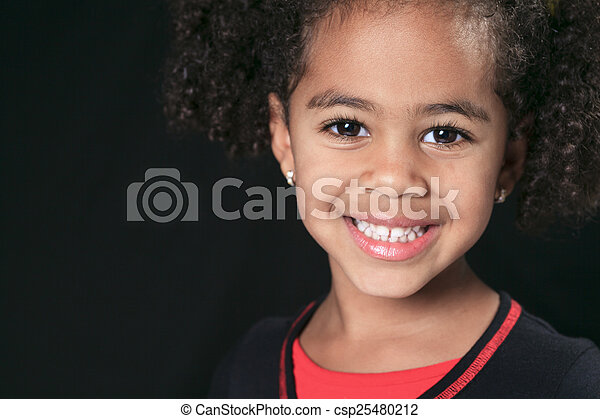 Portrait of a cute african american little boy, isolated on blac - csp25480212