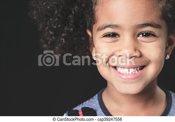 Portrait of a cute african american little boy, isolated on blac - csp39247556