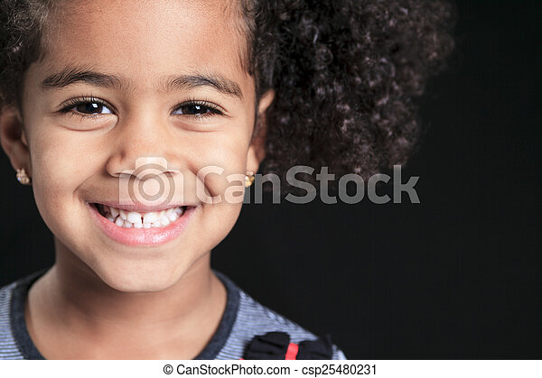 Portrait of a cute african american little boy, isolated on blac - csp25480231