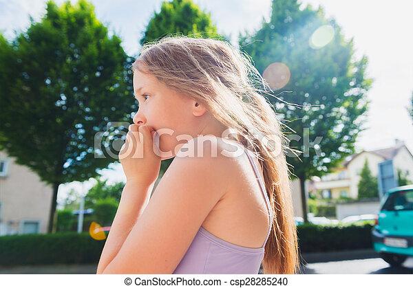 Portrait of a cute little girl in a city - csp28285240