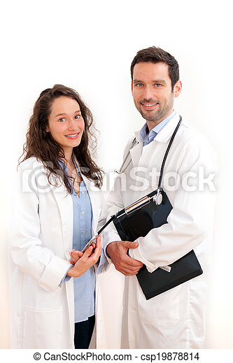 Portrait of a doctor with his nurse - csp19878814