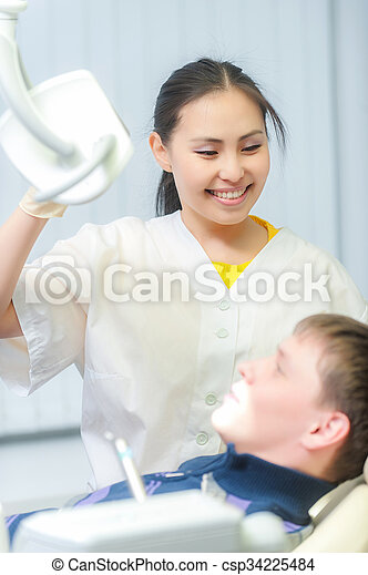 Portrait of a friendly dentist in dental clinic - csp34225484