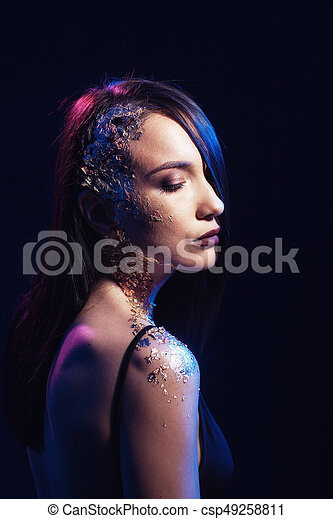 Portrait of a girl on a black background - csp49258811
