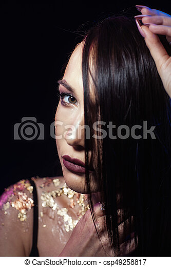 Portrait of a girl on a black background - csp49258817