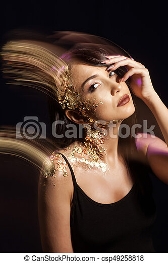 Portrait of a girl on a black background - csp49258818