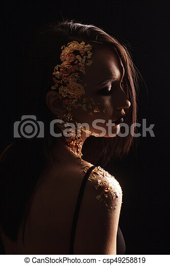 Portrait of a girl on a black background - csp49258819