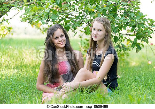 Portrait of a girl with long hair in the garden - csp18509499