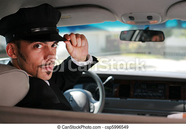 Portrait of a handsome male chauffeur sitting in a car saluting a viewer.+ - csp5996549