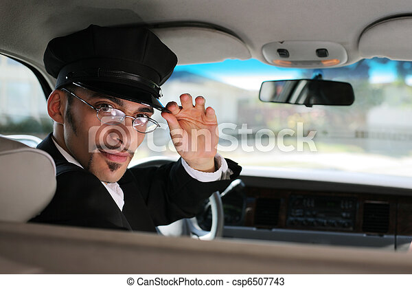 Portrait of a handsome male chauffeur sitting in a car saluting a viewer - csp6507743