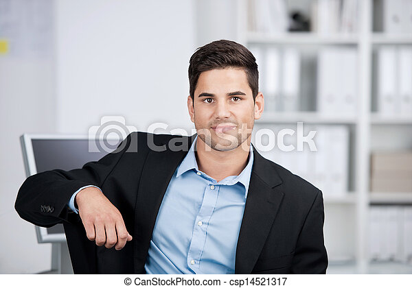 Portrait of a handsome smiling businessman - csp14521317
