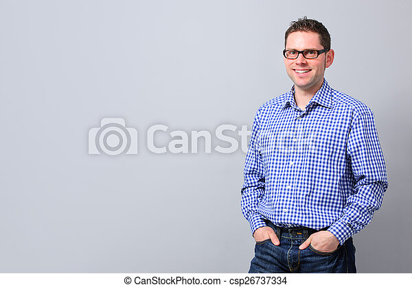 Portrait of a handsome young man smiling - csp26737334