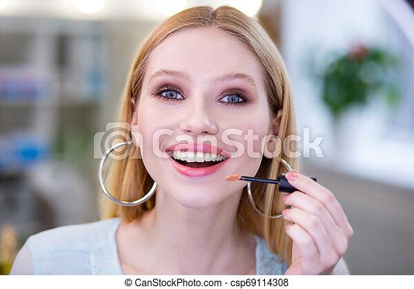 Portrait of a happy blonde woman smiling - csp69114308