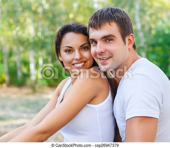 Portrait of a happy couple laughing at camera - csp26947379