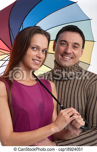 Portrait of a happy couple laughing at camera - csp18924051