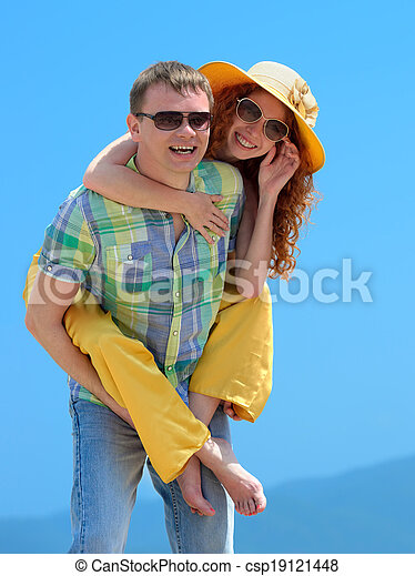 Portrait of a happy couple laughing at camera - csp19121448