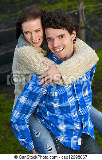 Portrait of a Happy Couple Smiling Outdoors - csp12398067
