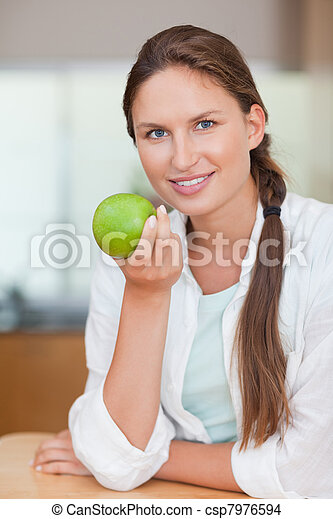 Portrait of a happy woman with an apple - csp7976594