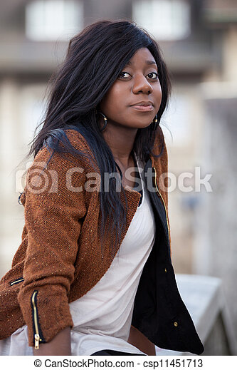 Portrait of a happy young african american teenage woman - csp11451713