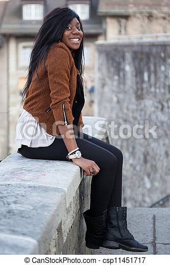 Portrait of a happy young african american teenage woman - csp11451717