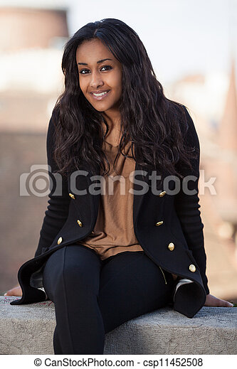 Portrait of a happy young african american teenage woman - csp11452508
