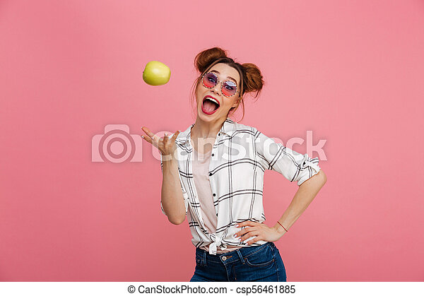 Portrait of a happy young girl in sunglasses with green apple - csp56461885