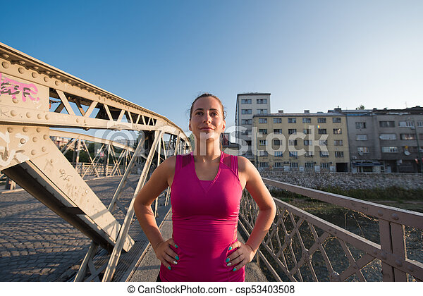 portrait of a jogging woman at sunny morning - csp53403508