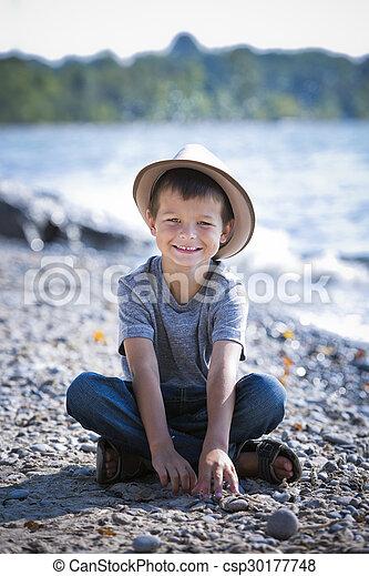 bd5bbd1b553 Portrait of a little boy wearing hat. Caucasian boy smiling wearing ...