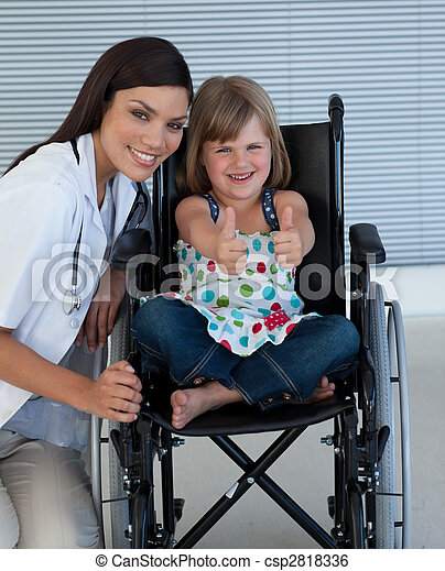 Portrait of a little girl on a wheelchair with her doctor  - csp2818336