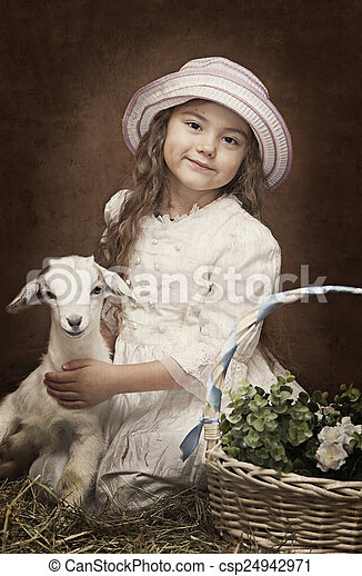 Portrait of a little girl with a baby goat - csp24942971