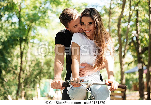 Portrait Of A Lovely Couple Riding On A Bicycle Together Portrait New Lovely Couple Com