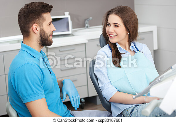 Portrait of a male dentist and young happy  female patient. - csp38187681