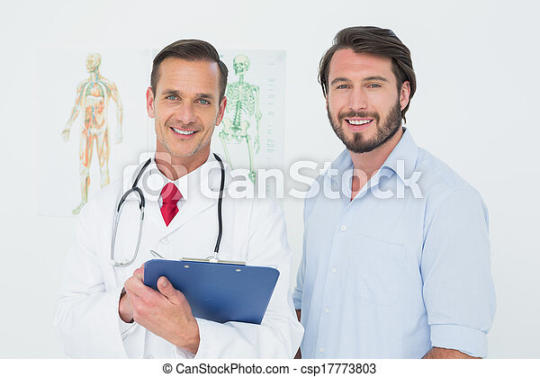 Portrait of a male doctor and patient with reports - csp17773803
