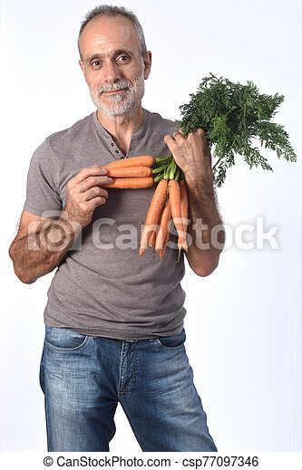 portrait of a man with carrot on white background - csp77097346