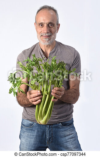 portrait of a man with celery on white background - csp77097344