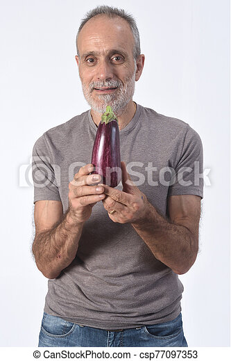 portrait of a man with eggplant on white background - csp77097353