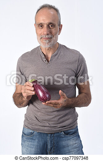 portrait of a man with eggplant on white background - csp77097348