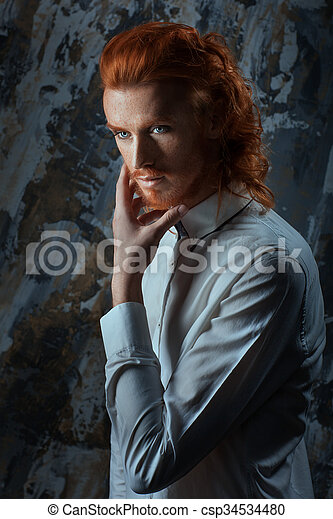 Portrait of a man with fiery curls on his head. - csp34534480