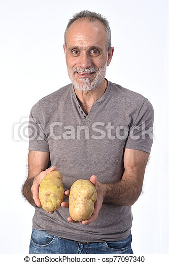 portrait of a man with potatoes on white background - csp77097340