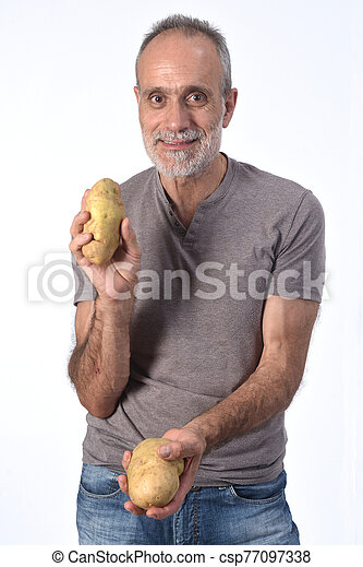 portrait of a man with potatoes on white background - csp77097338
