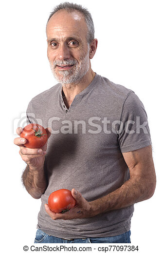 portrait of a man with tomatoes on white background - csp77097384