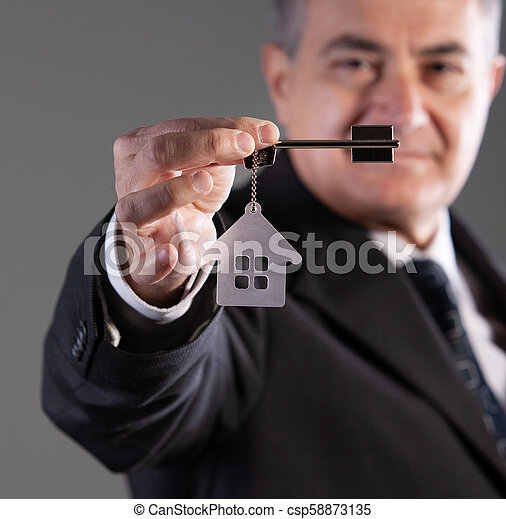 portrait of a mature man with house key - csp58873135
