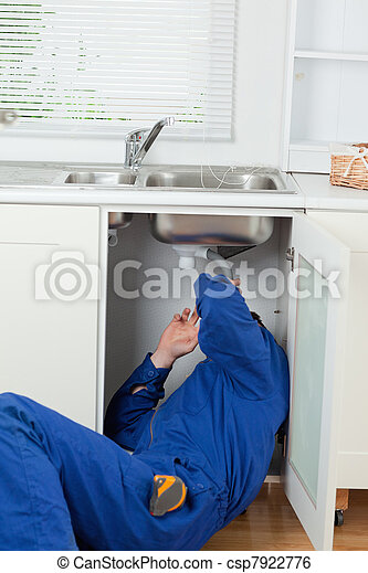 Portrait of a plumber fixing a sink - csp7922776