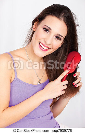 Portrait of a pretty woman combing her hair - csp7939776